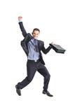 Um salto novo feliz do homem de negócios Fotografia de Stock