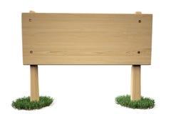 Um sinal de madeira na grama Foto de Stock Royalty Free