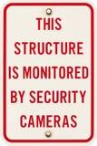 Um sinal de rua da monitoração da câmara de segurança Foto de Stock
