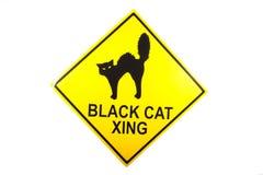 Um sinal do cruzamento do gato preto para Dia das Bruxas Fotos de Stock Royalty Free