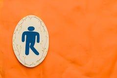 Um sinal do toalete do homem Imagem de Stock