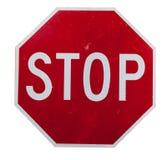 Um sinal vermelho do batente no branco Fotos de Stock