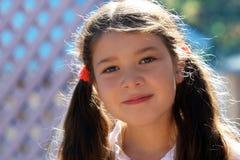 Um sorriso da menina fotografia de stock royalty free