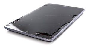 Um tablet pc quebrado fotografia de stock
