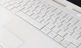 Um teclado branco fotografia de stock