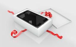 um telefone celular em um cartão branco Imagens de Stock