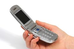 Um telemóvel está em uma mão, em um fundo branco Imagens de Stock Royalty Free