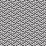 Um teste padrão geométrico de desenhos em espinha em um fundo branco Fotografia de Stock Royalty Free