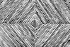 Um teste padrão romboidal do fundo velho das placas de madeira, do preto e do wite fotos de stock royalty free