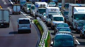 Um timelapse da rua do carro na avenida de Kanpachi na inclinação do dia do Tóquio filme