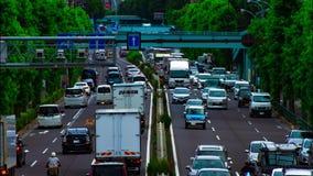 Um timelapse da rua do carro na avenida de Kanpachi na inclinação do dia do Tóquio vídeos de arquivo