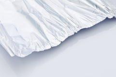 Um tinfoil enrugado fatia Fotografia de Stock