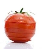 Um tomate cortado fotografia de stock