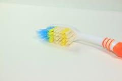 Um toothbush velho imagens de stock