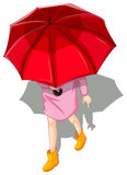 Um topview de uma mulher que usa o guarda-chuva Fotos de Stock Royalty Free