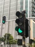Um tráfego da luz verde na estrada de Hong Kong Foto de Stock Royalty Free