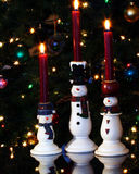 Um trio de velas do boneco de neve Fotos de Stock Royalty Free