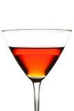Um vidro com um cocktail vermelho imagens de stock royalty free