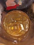 Um vidro da cerveja com gelo Foto de Stock