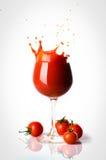 Um vidro do suco de tomate Imagem de Stock