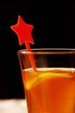 Um vidro do sumo de laranja Imagens de Stock Royalty Free