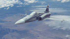 Um voo do avião de combate em uma alta altitude sobre um terreno e montanhas do deserto Imagens de Stock