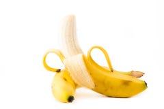 Uma única banana descascada para baixo Fotos de Stock