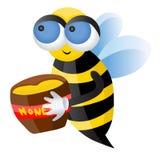 Uma abelha com mel Fotografia de Stock