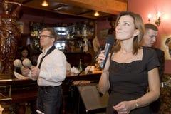 Uma apresentação estimulando do desempenho dos músicos do cocktail do grupo do PNF Imagem de Stock