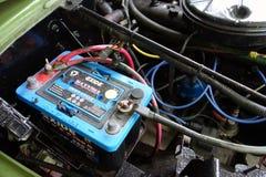 Uma bateria nova em um jipe velho Imagem de Stock Royalty Free