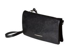 Uma bolsa da mulher negra com correia Imagem de Stock