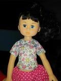 Uma boneca da menina Fotos de Stock