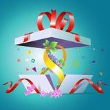 Uma caixa de presente aberta para feriado o 8 de março Foto de Stock