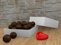 Uma caixa dos chocolates Fotos de Stock Royalty Free