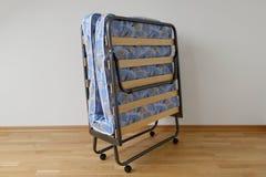 Uma cama de dobramento Imagens de Stock Royalty Free