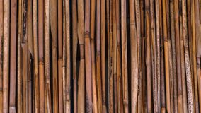 Uma cerca da palha em um estilo tropical foto de stock royalty free