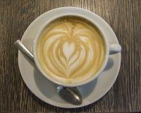 Uma chávena de café com creme Imagem de Stock Royalty Free