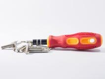 Uma chave de fenda é uma ferramenta Fotografia de Stock Royalty Free