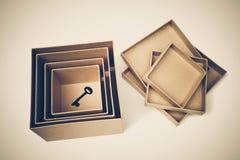 Uma chave em umas caixas secretas Foto de Stock Royalty Free