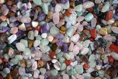 Uma coleção das gema-pedras no remendo do risco Imagem de Stock Royalty Free