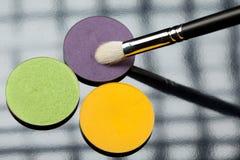 Uma composição da escova da sombra de olho três Foto de Stock Royalty Free