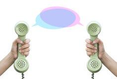 Uma comunicação Telefone retro da posse da mão Imagens de Stock Royalty Free