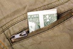Uma conta de dólar em um bolso Fotos de Stock Royalty Free