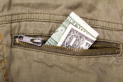 Uma conta de dólar em um bolso Fotos de Stock