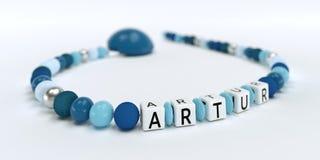 Uma corrente azul da chupeta para meninos com nome Artur Imagens de Stock Royalty Free