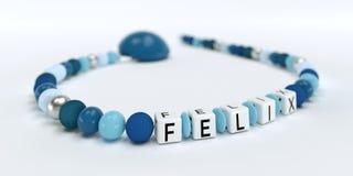 Uma corrente azul da chupeta para meninos com nome Felix Fotografia de Stock