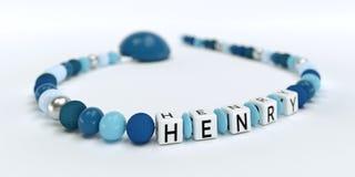 Uma corrente azul da chupeta para meninos com nome Henry Imagem de Stock Royalty Free