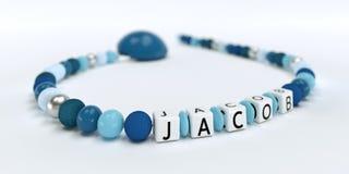 Uma corrente azul da chupeta para meninos com nome Jacob Imagem de Stock Royalty Free