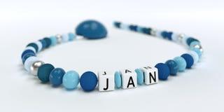 Uma corrente azul da chupeta para meninos com nome janeiro Fotos de Stock Royalty Free