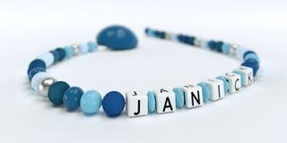 Uma corrente azul da chupeta para meninos com nome Janick Imagem de Stock